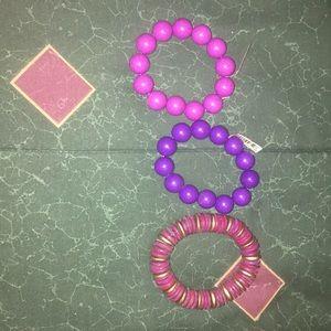 3 purple bracelets